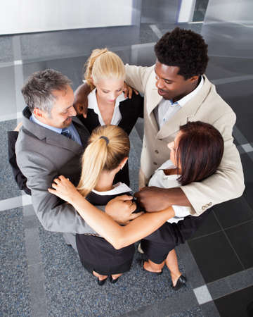 team spirit: Group Happy Business People Making Huddle On The Office