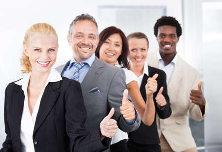 multiracial groups: Group Of Happy Multiracial Businesspeople Standing In A Row