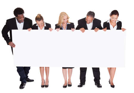 Group Of Happy Business People With Placard Over White Background Stock Photo