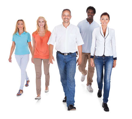 person walking: Happy Casual Group Of People Standing Over White Background Stock Photo