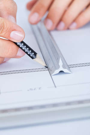 Close-up Of Male Architect Working On Blueprint At Desk Stock Photo - 21254351