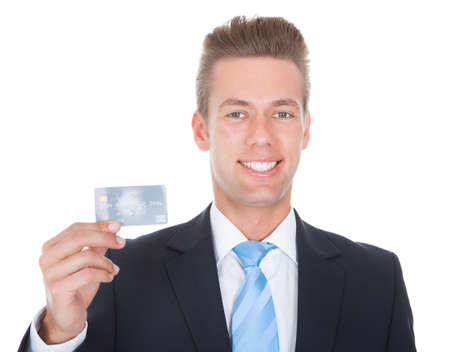 Close-up Of Businessman In Suit Holding Credit Card photo