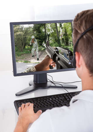 Photo Of Young Man Playing Computer Games Stock Photo - 21254453
