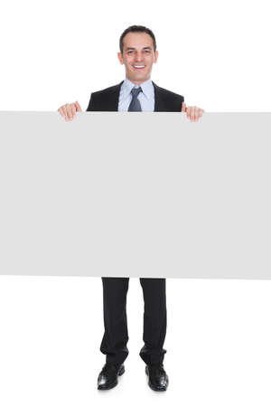 Happy Businessman Holding Placard Over White Background Stockfoto