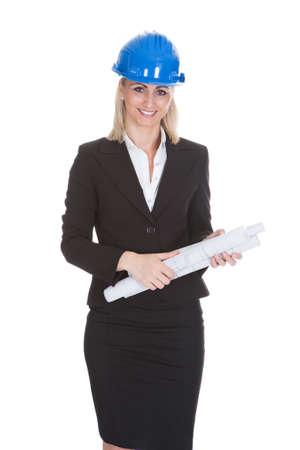 Portrait Of Happy Female Architect Holding Blueprint Over White Background Stock Photo - 21327831