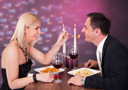 Romantic Young Couple Having Dinner At Restaurant photo