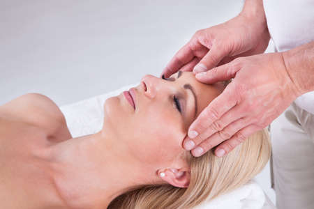 Beautiful Fresh Woman Having Facial Massage In Spa Centre Stock Photo - 21327958