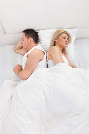 Loving Couple Sleeping Lying In Bed At Home photo