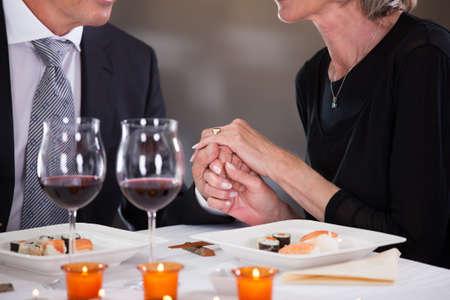 Romantic Couple Having Dinner At The Restaurant photo