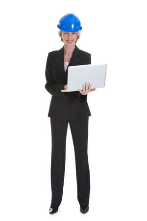 Portrait Of Female Architect Using Laptop On White Background photo