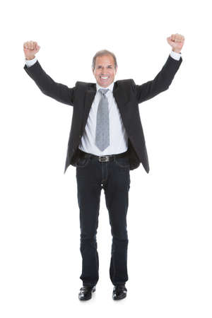 front raise: Portrait Of Excited Businessman Raising Hand Over White Background