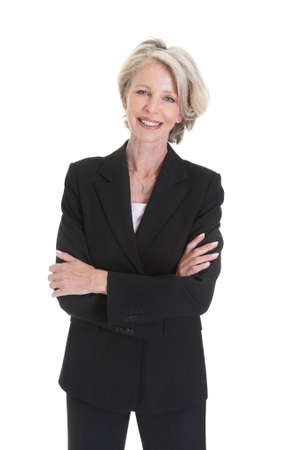 business woman standing: Portrait Of Excited Businesswoman Raising Hand On White Background