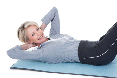 woman from behind: Happy Mature Woman In Fitness Attire Exercising On White Background Stock Photo