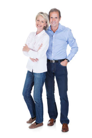 mature adult women: Portrait Of Happy Mature Lovely Couple Isolated Over White Background Stock Photo