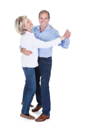dance pose: Happy Mature Couple Dancing Isolated Over White Background