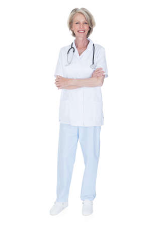 Portrait Of Happy Mature Female Doctor Isolated Over White Background photo