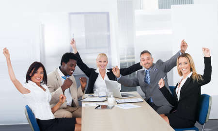 Group Of Excited Multi Ethnic Businesspeople In Office photo