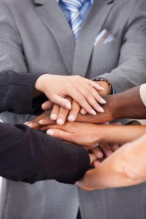 pledge: Group Of Multiracial People Stacking Hands Over Each Other