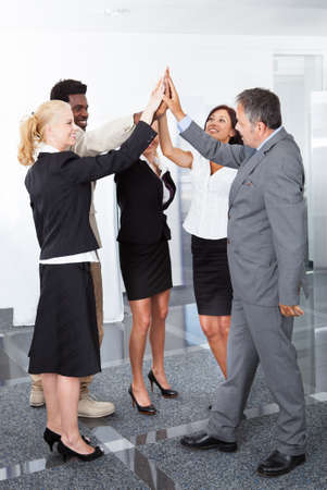 Successful Multiracial Business People Celebrating With A High-five photo