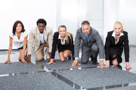 Multiracial Businesspeople In A Row Being Ready For Competition photo
