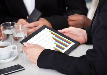 wireless technology: Close-up Of Businessperson Analyzing Business Graph On Digital Tablet