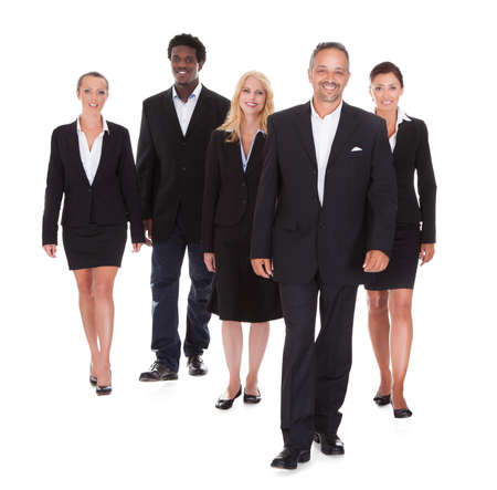 Happy Group Of Business People Standing Over White Background photo