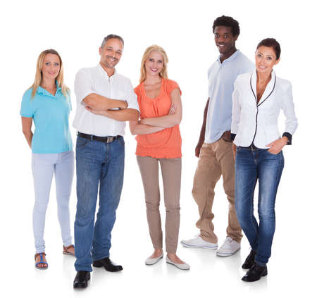 Happy Casual Group Of People Standing Over White Background Stock Photo