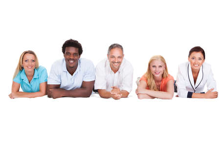 diverse family: Happy Friends Lying In A Row Isolated On White Background Stock Photo