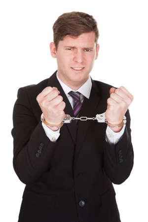 Portrait of criminal businessman isolated over white background Stock Photo - 21328453
