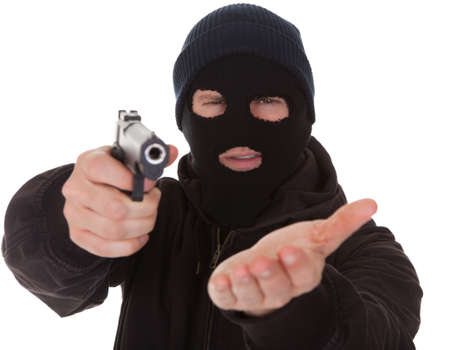 Burglar Wearing Mask Aiming Gun Towards Camera photo