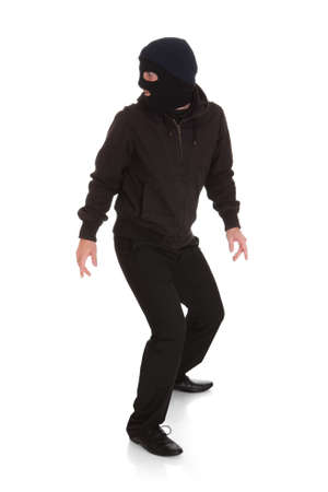 Man Wearing Mask Looking Back Over White Background