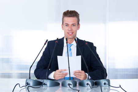 politician: Young Businessman Giving Speech In The Conference Stock Photo