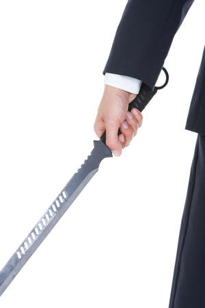 Young Businessman Standing With Sword Over White Background photo