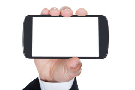 holding cell: Close-up Of Hand Holding Cell Phone Over White Background Stock Photo