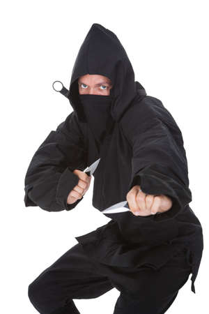 ninja weapons: Portrait Of Male Ninja In Black Costume Isolated Over White Background