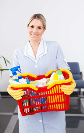 Young Happy  Maid Carrying Cleaning Equipment Stock Photo - 21328935