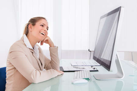 Portrait Of Young Businesswoman Using Computer In The Office photo
