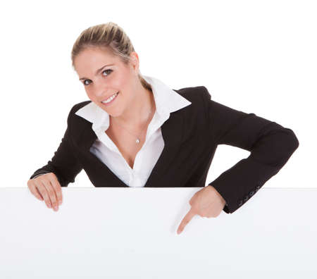 Happy Young Businesswoman Holding Empty Placard Over White Background photo