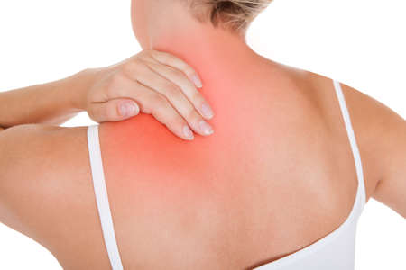human neck: Close up of woman having back pain isolated on white background