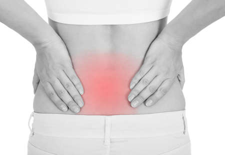 Close up of woman having back pain isolated on white background photo