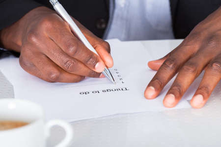 body writing: Close-up Of Businessman Hand Planning To Do List