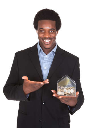 Young African Businessman Showing His Money Box Isolated Over White Background photo