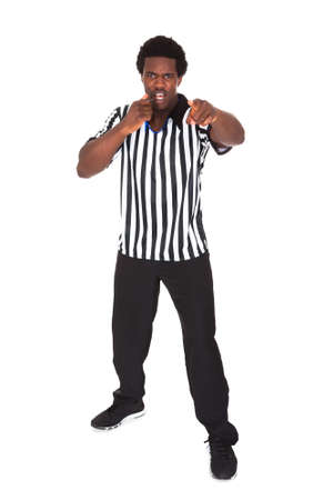 Portrait Of African Referee Isolated Over White Background photo