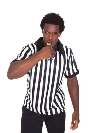 soccer coach: Portrait Of African Referee Isolated Over White Background