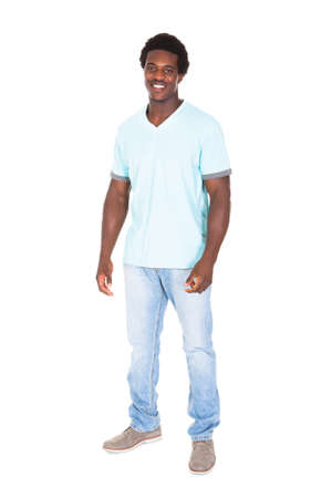 Portrait Of Casual Young African Man Isolated Over White Background photo