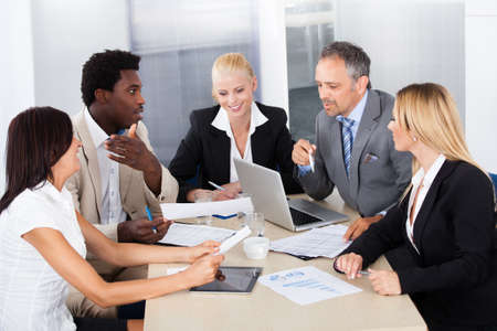 diverse group of people: Group Of Multi Ethnic Businesspeople Discussing Together In Office