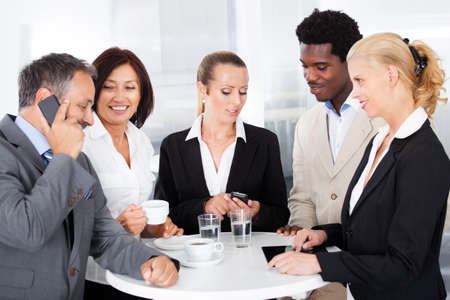 Group Of Happy Multiracial Businesspeople Taking A Break photo