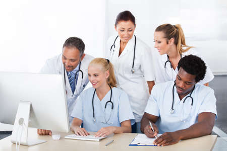 Group Of Happy Multiracial Doctors Working Together In Clinic photo