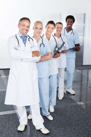 Group Of Happy Multiracial Doctors Standing In A Row photo