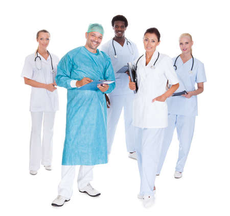 Doctor In Surgical Gown With His Coworkers Isolated Over White Background photo